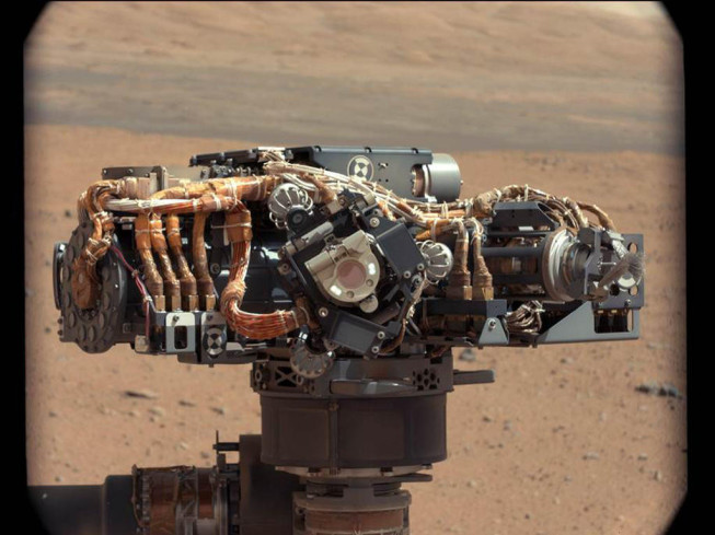 A photograph of one of the rover's cameras, with Mars in the background. Photo: NASA/JPL-Caltech/MSSS.