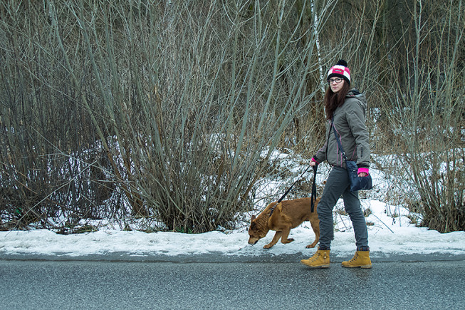 """Both the girl and the dog are still roughly on one of the """"thirds"""" intersections, and now their movement is leading """"into"""" the photo. Photo: Majo Eliáš"""