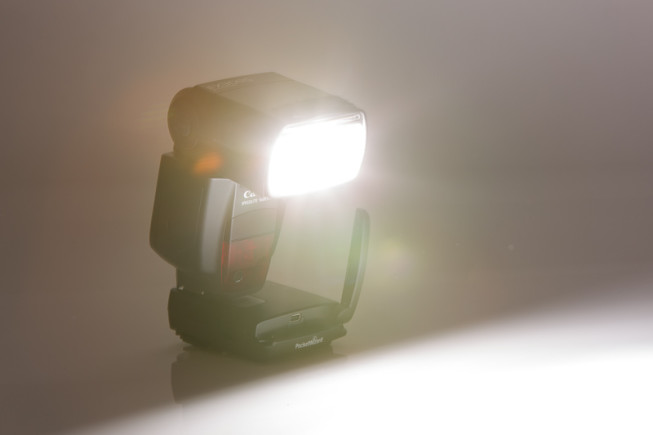 A Canon 580EX II external flash unit with a PocketWizard FlexTT5 remote trigger, outside the camera body. Photo: Vít Kovalčík