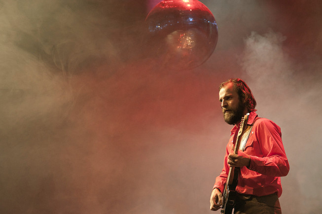 Even when you're shooting from the back row of a concert without a telephoto lens, try to give it life, for example by composing an interesting object into it. Here I used a hanging disco ball. My lens was an 85mm. (Please The Trees) Photo: Tomáš Bartoš